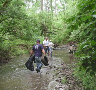 volunteers help clean up a creek
