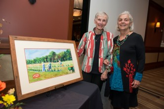 At the inaugural Legacy Society Dinner, Sue Grimm (left) was presented with the Art of Caring Award, created by friend and local artist, Carol Prior (right).